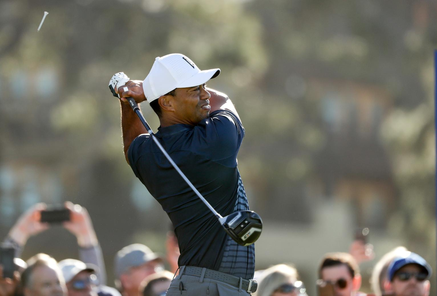 the latest  a clutch birdie by woods allows him to make