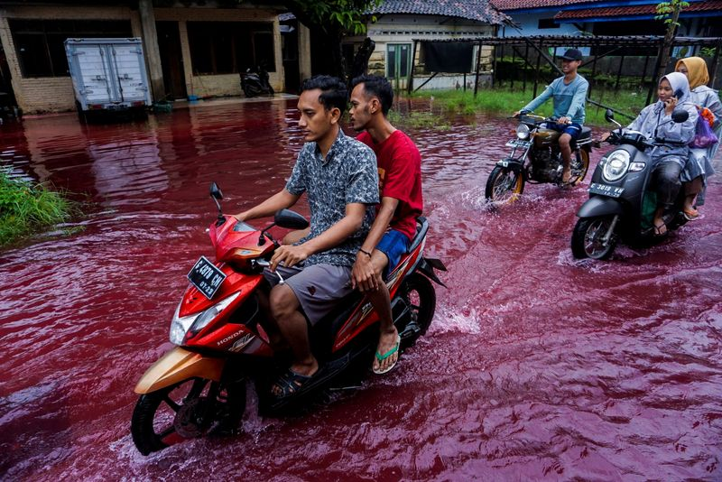 Streets of Indonesian Village Run Blood Red After Floods Hit Nearby Batik Factory