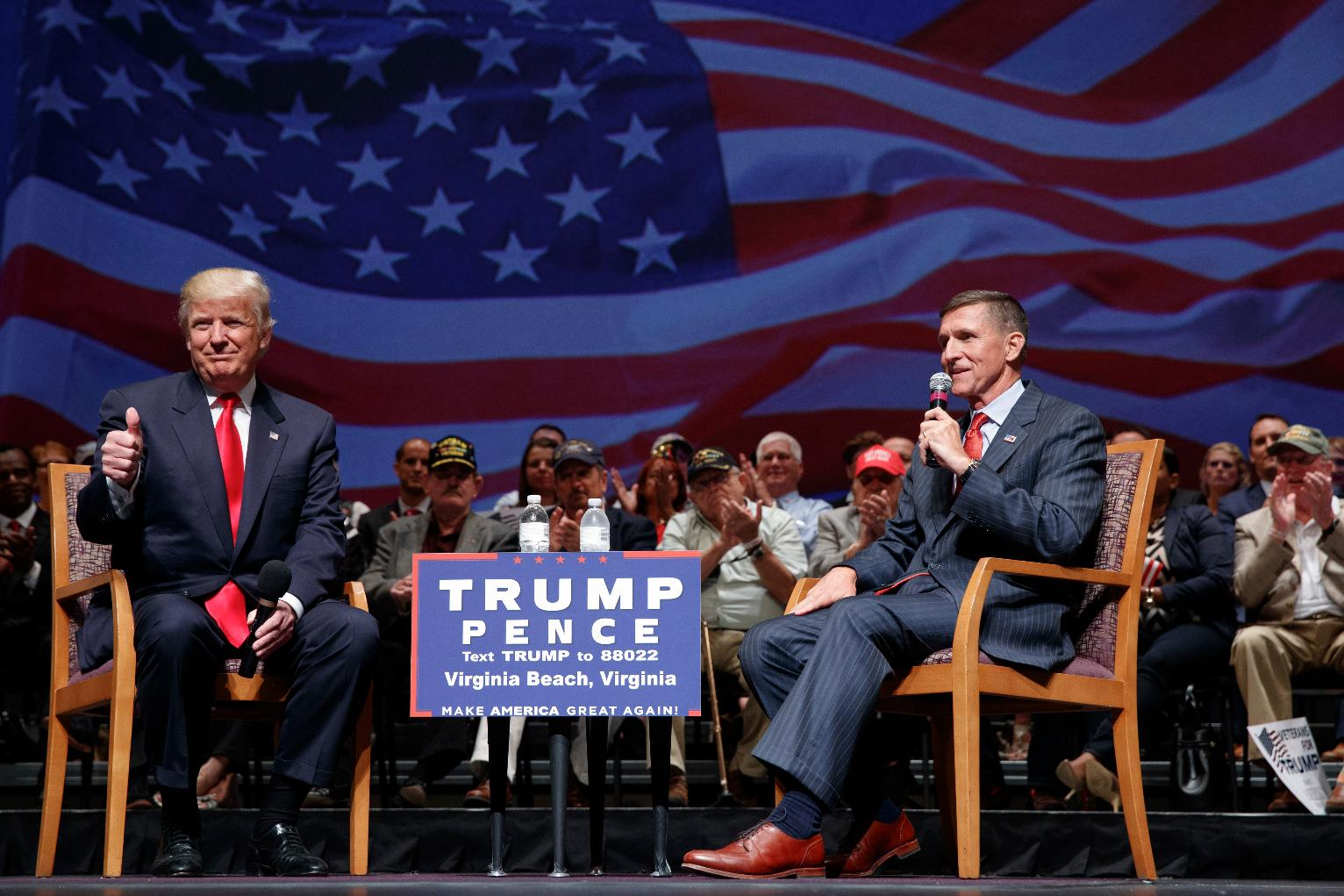 President Trump and Michael Flynn speaking on a stage at a campaign rally