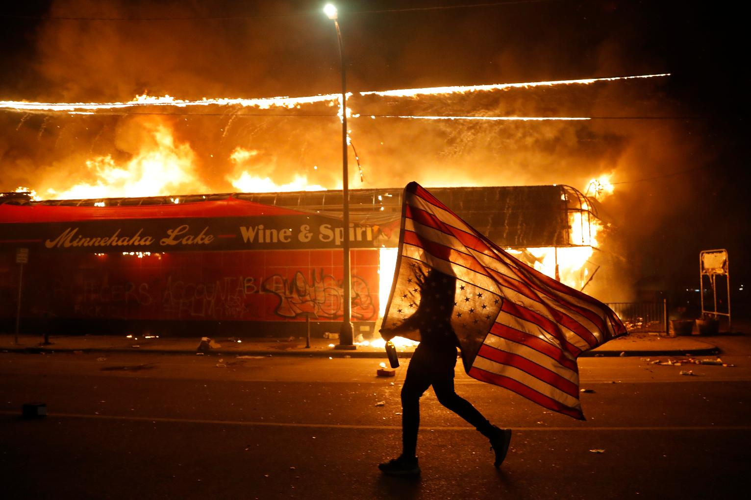 AP Photo of Flag-Bearing Protester Rockets Around the World ...