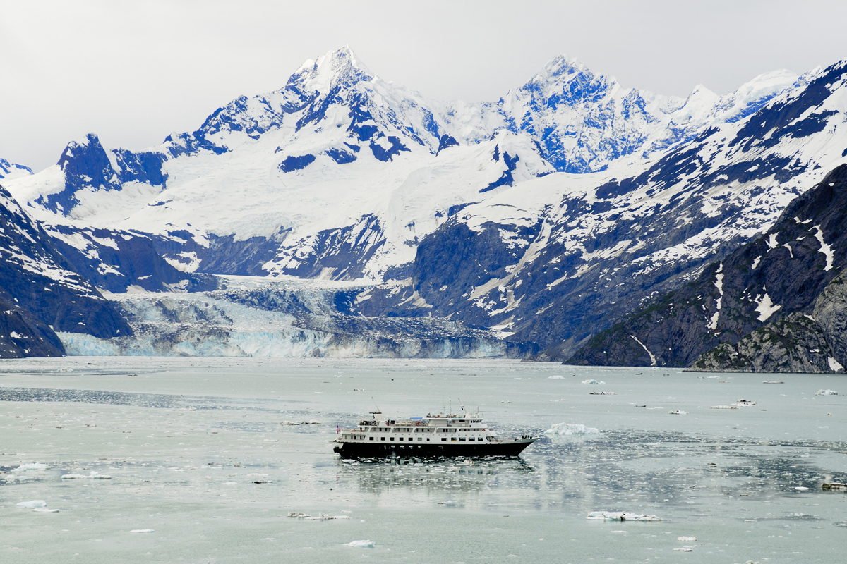 Mountains and glaciers near a cruise ship in Glacier Bay National Park, Alaska.
