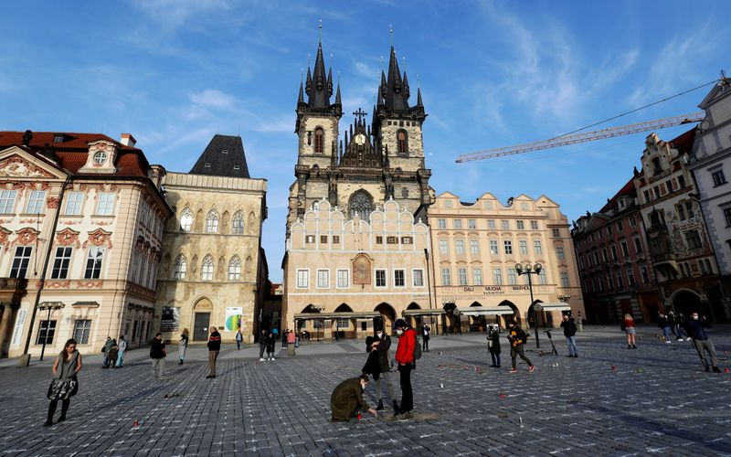 Mourners Make Prague's Old Town Square Into Memorial for Coronavirus Victims